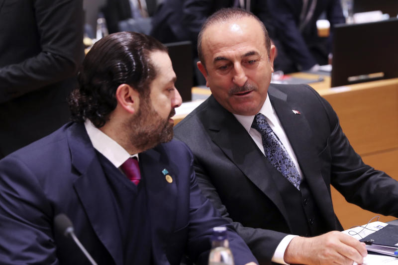 "Turkish Foreign Minister Mevlut Cavusoglu, right, talks to Lebanon's Prime Minister Saad Hariri during a Syria donors conference at the European Council headquarters in Brussels, Thursday, March 14, 2019. The European Union's top diplomat says the EU expects ""significant pledges"" for Syria at a donor conference, as the bloc seeks to keep the 8-year conflict in the international spotlight. (AP Photo/Francisco Seco)"