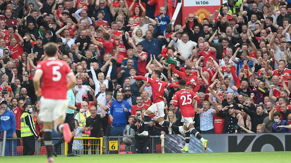 Seen here, fans erupt inside Old Trafford after Cristiano Ronaldo scores a goal on his return.
