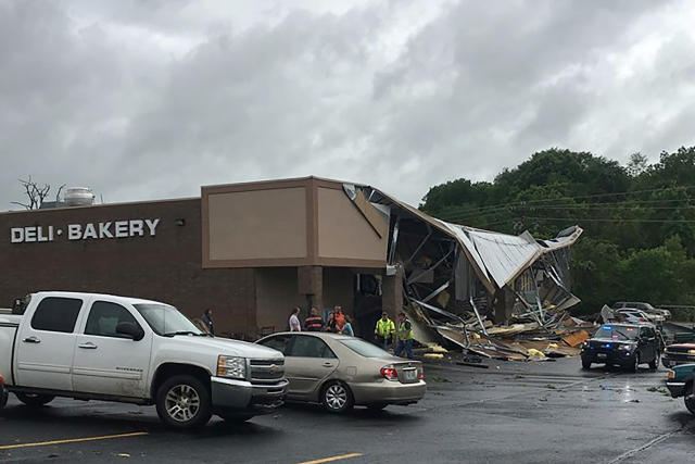 This Tuesday, May 21, 2019 photo released by Missouri State Highway Patrol shows the storm damage from a suspected tornado in Wright County at the Town and Country Supermarket in Hartville, Mo. Forecasters say parts of Oklahoma, Missouri and Kansas could see more severe weather Wednesday. (Missouri State Highway Patrol via AP)
