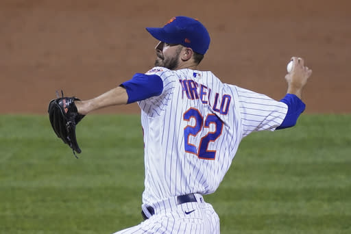 New York Mets starting pitcher Rick Porcello winds up during the third inning of the team's baseball game against the Philadelphia Phillies, Friday, Sept. 4, 2020, in New York. (AP Photo/John Minchillo)