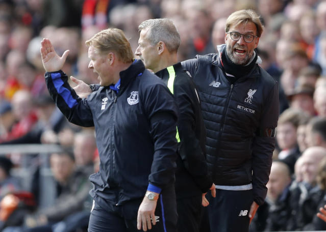 """<p>Britain Soccer Football – Liverpool v Everton – Premier League – Anfield – 1/4/17 Liverpool manager Juergen Klopp and Everton manager Ronald Koeman clash as fourth official Martin Atkinson looks on Action Images via Reuters / Carl Recine Livepic EDITORIAL USE ONLY. No use with unauthorized audio, video, data, fixture lists, club/league logos or """"live"""" services. Online in-match use limited to 45 images, no video emulation. No use in betting, games or single club/league/player publications. Please contact your account representative for further details. </p>"""