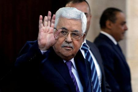 FILE PHOTO - Palestinian President Mahmoud Abbas waves in Ramallah, in the occupied West Bank