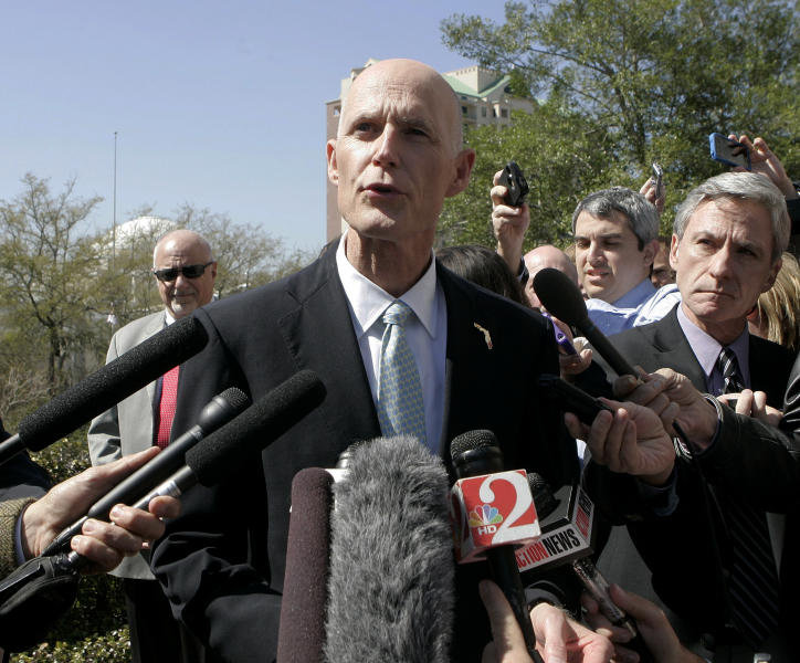 Florida Gov. Rick Scott make a statement at a news conference concerning Lt. Gov. Jennifer Carroll's resignation on Wednesday, March 13, 2013, in Tallahassee, Fla. Florida's lieutenant governor resigned and nearly 60 other people were charged in a scandal involving a purported veterans charity that authorities said Wednesday was a $300 million front for illegal gambling. (AP Photo/Steve Cannon)