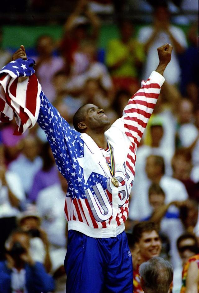 "Magic Johnson of the United States celebrates after receiving his gold medal on the 1st place podium during the 1992 Barcelona Olympics in Barcelona, Spain.<br><br><b>Also on Shine:</b><br><a href=""http://shine.yahoo.com/author-blog-posts/team-mom-pep-talk-kristi-yamaguchi-lessons-lifelong-132800152.html"" data-ylk=""slk:Team Mom Pep Talk with Kristi Yamaguchi: Lessons from a Lifelong Athlete"" class=""link rapid-noclick-resp"">Team Mom Pep Talk with Kristi Yamaguchi: Lessons from a Lifelong Athlete</a><br><a href=""http://shine.yahoo.com/team-mom/study-pee-wee-pop-warner-football-players-nfl-220600310.html;_ylt=An.8Bppjyq5hfVSqS4pA7jNWkqU5;_ylu=X3oDMTF1ams3Y3RuBG1pdANDeFMgUFNPTSBIdWIgQmxvZyBQb3N0cyBQcm9kBHBvcwMxMwRzZWMDTWVkaWFCbG9nSW5kZXhUZW1w;_ylg=X3oDMTFrM25vcXFyBGludGwDdXMEbGFuZwNlbi11cwRwc3RhaWQDBHBzdGNhdAMEcHQDc2VjdGlvbnMEdGVzdAM-;_ylv=3"" data-ylk=""slk:Study: Pee Wee and Pop Warner Football Players Take NFL-Like Hits"" class=""link rapid-noclick-resp"">Study: Pee Wee and Pop Warner Football Players Take NFL-Like Hits</a><br><a href=""http://shine.yahoo.com/team-mom/10-ways-cheer-kids-without-being-annoying-embarrassing-181600750.html"" data-ylk=""slk:10 Ways to Cheer on Your Kids Without Being Annoying and Embarrassing"" class=""link rapid-noclick-resp"">10 Ways to Cheer on Your Kids Without Being Annoying and Embarrassing</a>"