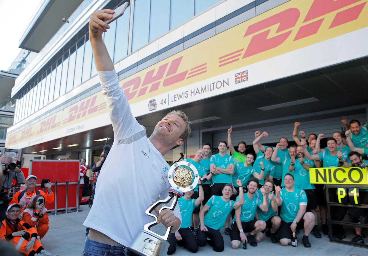 Formula One - Russian Grand Prix - Sochi, Russia - 1/5/16 Mercedes F1 driver Nico Rosberg of Germany shoots a selfie with the trophy and the Mercedes team. REUTERS/Maxim Shemetov