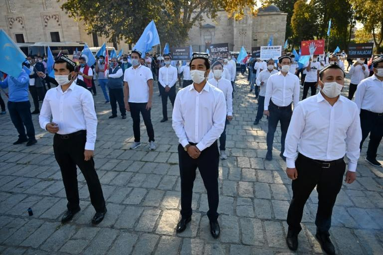 Members of China's Muslim Uighur minority who live outside China, like these protesting in Istanbul, are targets of systematic harassment, rendition and extradition efforts by Beijing, according to a Freedom House report