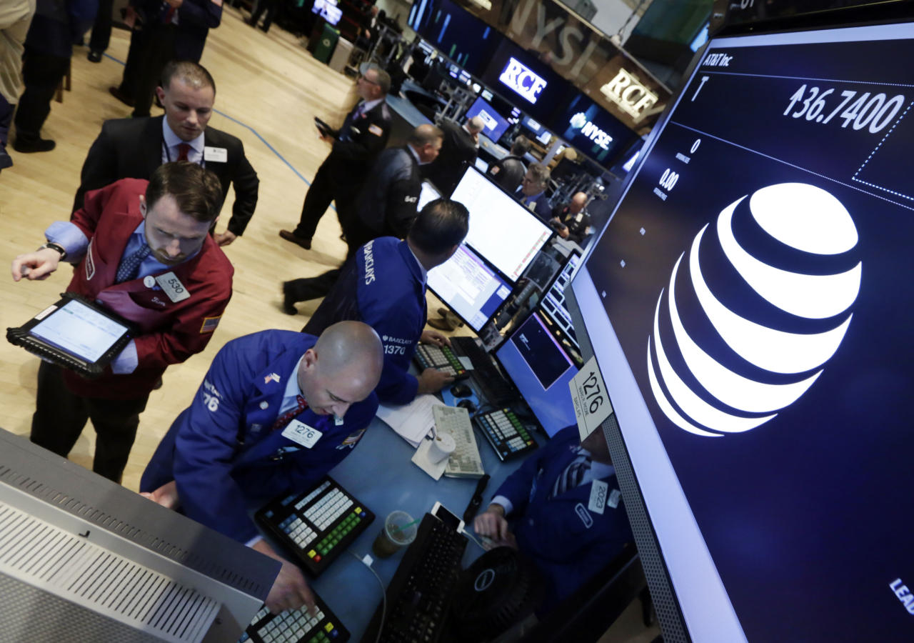 <p> FILE - In this Monday, May 19, 2014, file photo, traders gather at the post that handles AT&T on the floor of the New York Stock Exchange. There are already a few online services that aim to replace cable, but they don't have many users yet. AT&T's DirecTV hopes to change that. (AP Photo/Richard Drew, File) </p>