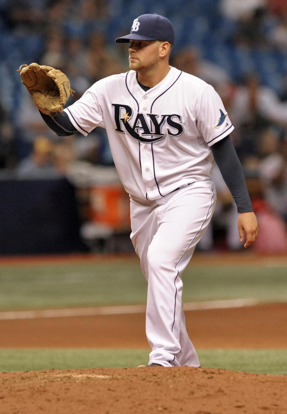 Tampa Bay Rays reliever C.J. Riefenhauser waits for a new ball after giving up a solo home run to Washington Nationals' Bryce Harper during the fifth inning of a baseball game Tuesday, June 16, 2015, in St. Petersburg, Fla. (AP Photo/Steve Nesius)