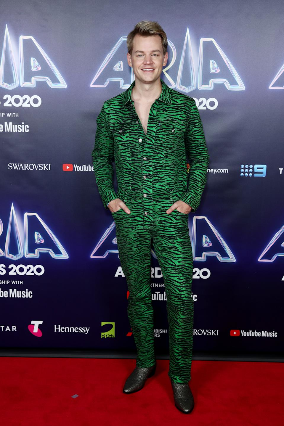 Joel Creasey wears a green zebra print boiler-suit by Kenzo on the red carpet at the 2020 ARIA Awards at The Star on November 24, 2020 in Sydney, Australia.