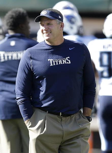 FILE - In this Nov. 24, 2013, file photo, Tennessee Titans head coach Mike Munchak watches as players warm up before an NFL football game against the Oakland Raiders in Oakland, Calif. person familiar with the decision say Titans President Tommy Smith has fired Munchak after three seasons as his head coach and 31 years combined with this franchise as a player and coach. The person spoke to The Associated Press on Saturday, Jan. 4, 2014, on the condition of anonymity because the Titans have not made an official announcement. (AP Photo/Ben Margot, File)