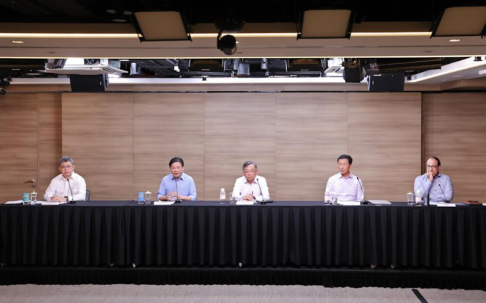 Singapore's multi-ministry task force on COVID-19 addresses reporters at a virtual media briefing (PHOTO: Ministry of Communications and Information)