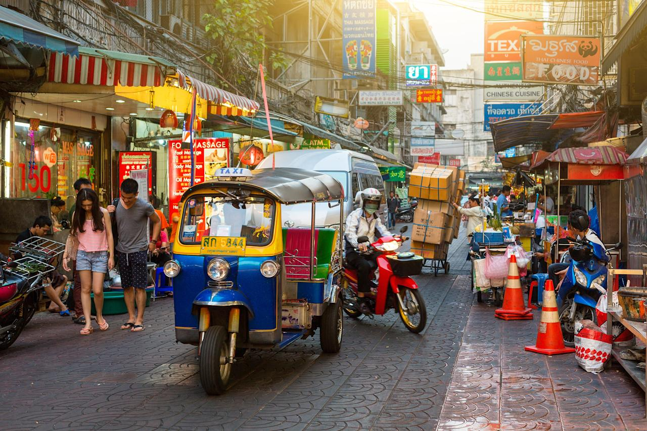 """<p><strong>What makes this neighborhood so special?</strong><br> Market lanes, glittery gold shops, phenomenal street food, temples with golden Buddhas, Daoist temples clouded with incense smoke, street art, history, and a neighborhood setting that feels untouched by time and modernization: Welcome to Bangkok's enchanting Chinatown. You don't need tickets or reservations, just an appetite for Thai-Chinese street food and a penchant for getting a little lost in the name of exploration.</p> <p><strong>What's it like being there?</strong><br> Hunger-inducing, a photographer's dream, something new to discover.</p> <p><strong>Will we need a guide to help navigate?</strong><br> While self-exploration is often best, hungry explorers will find the docent-led tours by the team at <a href=""""https://www.bangkokfoodtours.com"""">Bangkok Food Tours</a> truly engaging, and they'll discover some delicious, cheap eats. For deep dive on the history of the neighborhood, link up with <a href=""""https://www.smilingalbino.com/"""">Smiling Albino</a>.</p> <p><strong>Who else can you expect to see here?</strong><br> Fellow visitors are mostly locals there to shop for produce and household goods, visit a traditional Chinese medicine doctor, refill their supply of fragrant teas and goji berries, or hawk cash for gold chains. As for other foreigners, some have committed themselves to a full afternoon or evening in this atmospheric part of town; others pop in quickly before going to the trendy bars on Soi Nana, like <a href=""""https://www.cntraveler.com/bars/bangkok/teens-of-thailand?mbid=synd_yahoo_rss"""">Teens of Thailand</a> and <a href=""""https://www.cntraveler.com/restaurants/bangkok/tep-bar?mbid=synd_yahoo_rss"""">Tep Bar</a>.</p> <p><strong>Will it live up to our expectations?</strong><br> This is one of the largest Chinatowns in the world, so it's hard to imagine someone leaving here disappointed or feeling like they've covered the neighborhood in full. Even longtime residents are always finding someth"""