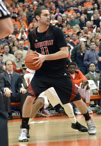 Louisville's Luke Hancock looks to pass against Syracuse during the second half of an NCAA college basketball game in Syracuse, N.Y., Saturday, March 2, 2013. Louisville won 58-53. (AP Photo/Kevin Rivoli)