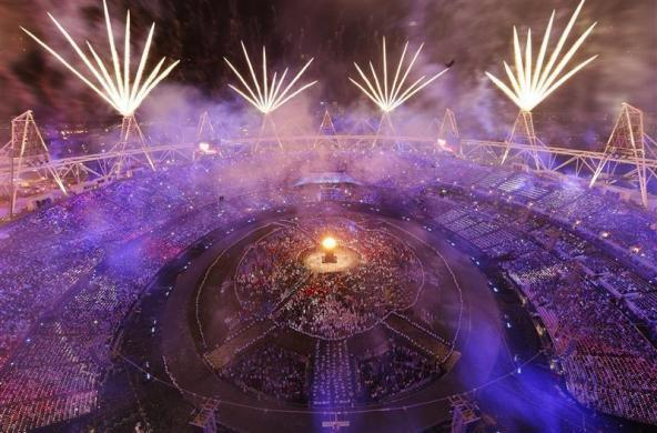 Fireworks explode over the lit Olympic Cauldron during the opening ceremony of the London 2012 Olympic Games at the Olympic Stadium July 27, 2012.