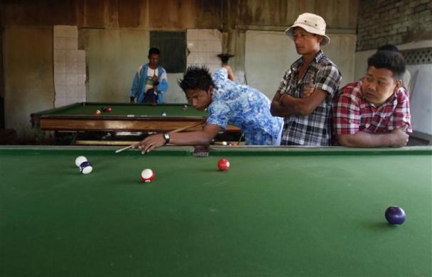 Young men play billiard in Kawhmu township, February 8, 2012.