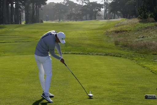 Li Haotong of China, hits his tee shot on the 10th hole during the second round of the PGA Championship golf tournament at TPC Harding Park Friday, Aug. 7, 2020, in San Francisco. (AP Photo/Charlie Riedel)