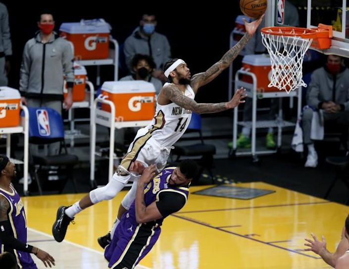 LOS ANGELES, CA - JANUARY 15: Brandon Ingram (14), of the Pelicans, commits a charging foul.
