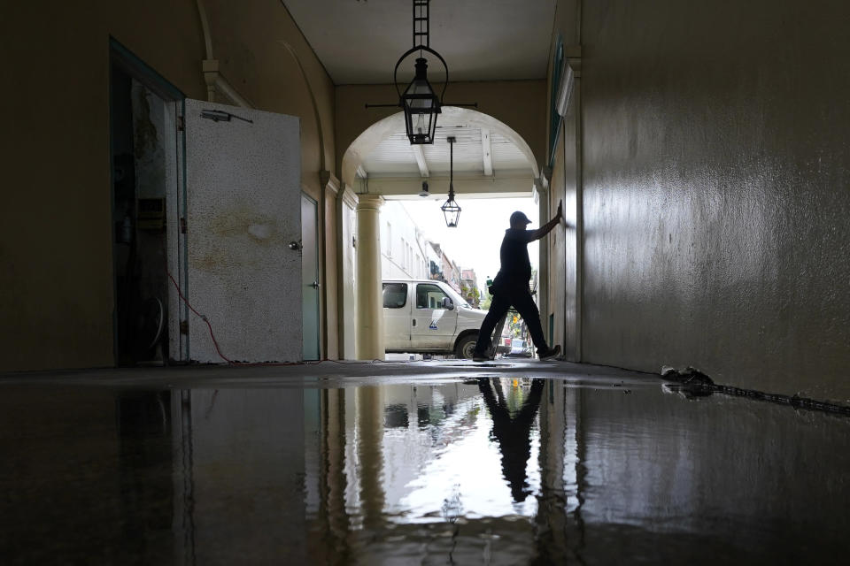 In preparation of Hurricane Ida, a worker attaches protective plywood to windows and doors of a business in the French Quarter in New Orleans, Saturday, Aug. 28, 2021. (AP Photo/Eric Gay)