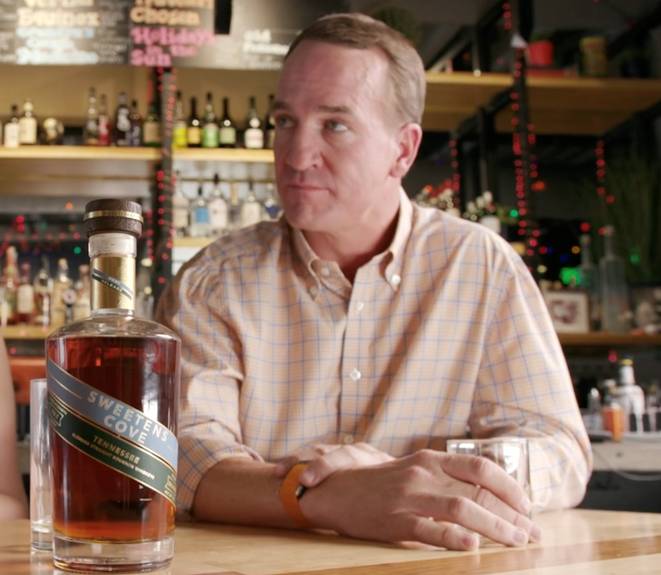 Peyton Manning is in the bourbon business, set to launch his Sweetens Cove brand in Indiana Sept. 22.