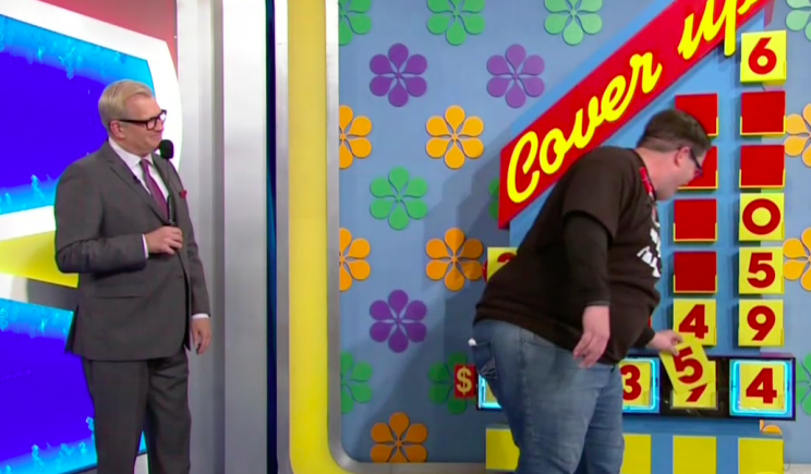 A contestant plays Cover Up as Drew Carey watches, on The Price Is Right
