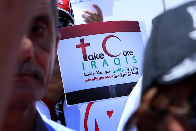 Iraqis gather during a demonstration on July 24, 2014, against the threat imposed by the Islamic State (IS) jihadists against Christians in northern Iraq, outside the UN office in Arbil, the capital of the autonomous Kurdish region