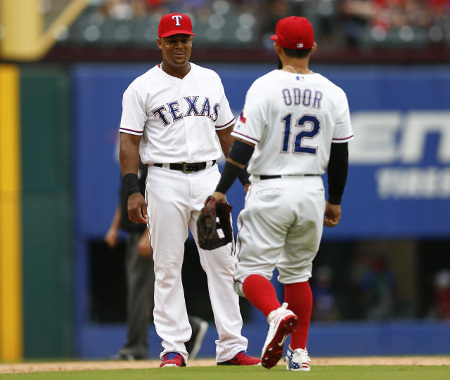 Texas Rangers third baseman Adrian Beltre, left, smiles as second baseman Rougned Odor (12) approaches while leaving a baseball game during the sixth inning against the Seattle Mariners, Sunday, Sept. 23, 2018, in Arlington, Texas. (AP Photo/Jim Cowsert)