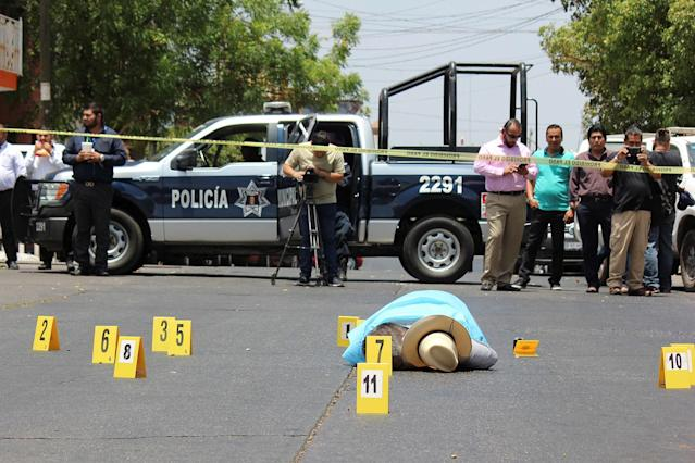 <p>Evidence identifiers are placed next to the body of journalist Javier Valdez at a crime scene in Culiacan, In Sinaloa state, Mexico on May 15, 2017. (Jesus Bustamante/Reuters) </p>