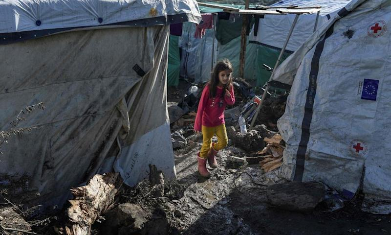 A girl walks on a muddy path at a makeshift camp next to the Moria refugee camp on Lesbos, Greece, on 29 November.