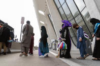 People evacuated from Kabul, Afghanistan, wait to board a bus after they arrived at Washington Dulles International Airport, in Chantilly, Va., on Monday, Aug. 30, 2021. (AP Photo/Jose Luis Magana)