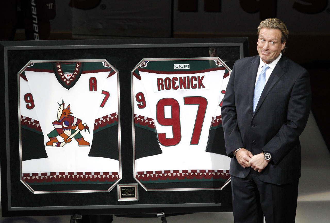 Former Phoenix Coyotes player Jeremy Roenick reacts during his induction into the Coyotes Ring of Honor before an NHL hockey game against the Chicago Blackhawks, Saturday, Feb. 11, 2012, in Glendale, Ariz. (AP Photo/Ross D. Franklin)