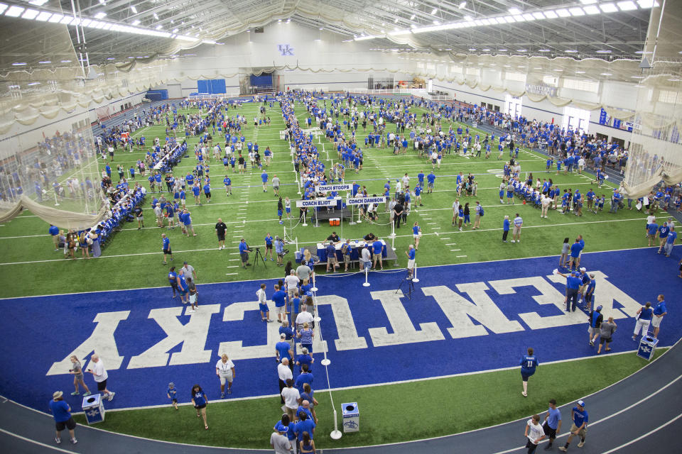 Kentucky fans fill Nutter Field House to meet their favorite players and coaches during the annual NCAA college football Fan Day in Lexington, Ky., Saturday, Aug. 8, 2015. (AP Photo/ David Stephenson)