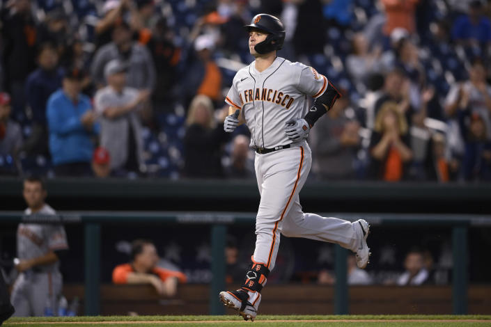 San Francisco Giants' Buster Posey heads home on his home run during the fourth inning of the team's baseball game against the Washington Nationals, Friday, June 11, 2021, in Washington. (AP Photo/Nick Wass)