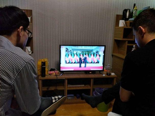 PHOTO: Students watch a documentary about the North Korea?United States Singapore Summit from their dorm room at Kim Il Sung University, Pyongyang, North Korea, June 14, 2018. (Courtesy Alek Sigley)