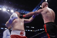 Sweden's Robert Helenius, right, punches Poland's Adam Kownacki during the second round of a heavyweight boxing match Saturday, March 7, 2020, in New York. Helenius stopped Kownacki in the fourth round. (AP Photo/Frank Franklin II)