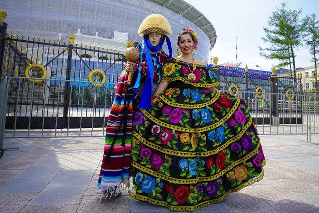 <p>Fans of Mexico pose outside the stadium prior to the 2018 FIFA World Cup Russia group F match between Mexico and Sweden at Ekaterinburg Arena on June 27, 2018 in Yekaterinburg, Russia. (Photo by Carlos Cuin/Jam Media/Getty Images) </p>