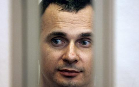 Oleg Sentsov in a defendant's cage during his 2015 trial, which was called unfair by Amnesty International - Credit: Sergey Venyavsky/AFP/Getty Images