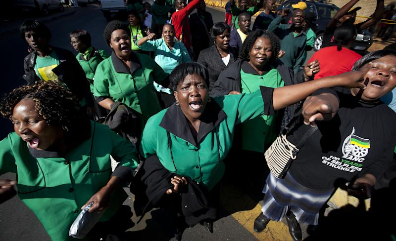 Members of the African National Congress (ANC) Women's League march and sing in support of former South African President Nelson Mandela outside the Mediclinic Heart Hospital where he is being treated in Pretoria, South Africa Thursday, July 4, 2013. A South African court ruled on Wednesday that Nelson Mandela's grandson Mandla Mandela must return the bodies of the former president's three deceased children to their original burial site. (AP Photo/Ben Curtis)