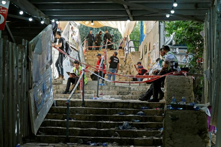 Rescue teams in the aftermath of a stampede at the scene of a religious gathering in Meron in northern Israel