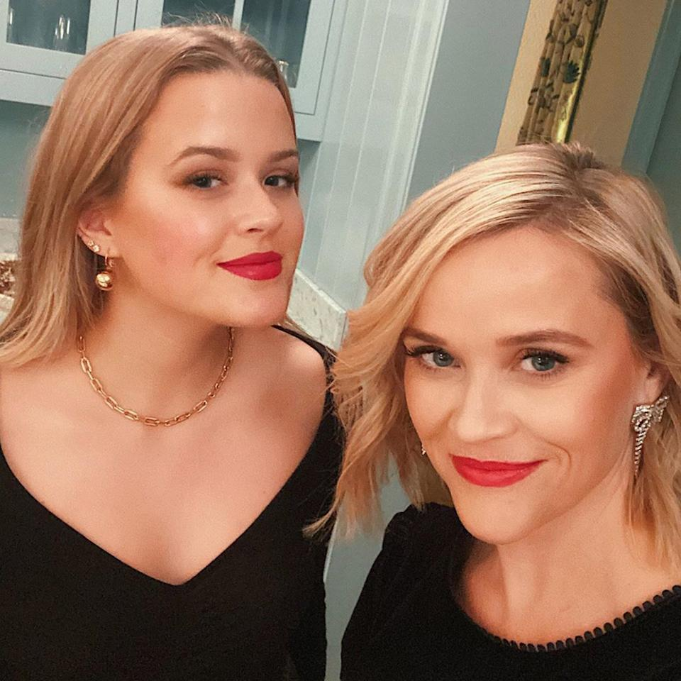 The mother-daughter duo got into the festive spirit with a classic red lip paired with black ensembles ahead of their Christmas celebrations.