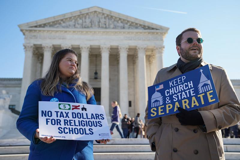People gather outside the Supreme Court during oral arguments in the Espinoza v. Montana Department of Revenue case on Jan. 22. (Sarah Silbiger / Reuters)