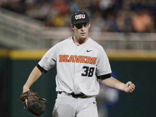 Oregon State closing pitcher Jake Mulholland clenches his fist after the last out of the eighth inning of an NCAA College World Series baseball elimination game against Mississippi State in Omaha, Neb., Saturday, June 23, 2018. (AP Photo/Nati Harnik)