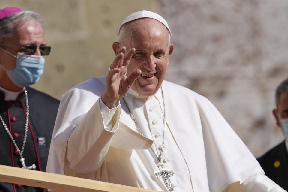 Pope Francis arrives at the Cathedral of Saint Martin, in Bratislava, Slovakia, Monday, Sept. 13, 2021. Francis is on a four-day visit to Central Europe, in Hungary and Slovakia, in his first big international outing since undergoing intestinal surgery in July. In the background is Archbishop Stanislav Zvolensky. (AP Photo/Petr David Josek)