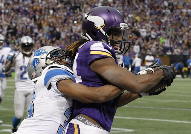 Minnesota Vikings wide receiver Cordarrelle Patterson, right, catches an 8-yard touchdown pass in front of Detroit Lions cornerback Chris Greenwood, left, during the second half of an NFL football game on Sunday, Dec. 29, 2013, in Minneapolis. (AP Photo/Ann Heisenfelt)
