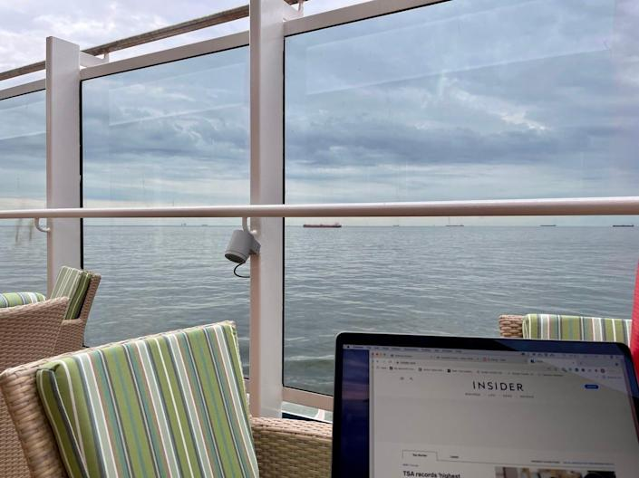 The author sits at an empty table on the Carnival Vista.