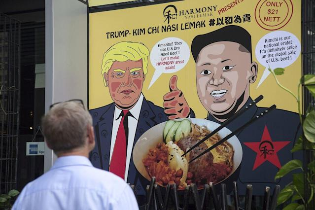 A promotional poster outside a Singapore eatery, Harmony Nasi Lemak, which offers a special Trump Kim-Chi dish on its menu on June 6, 2018. (Photo: Ore Huiying/Getty Images)