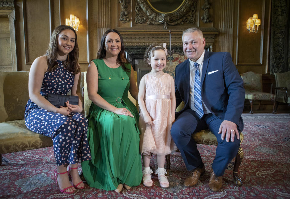 EDINBURGH, SCOTLAND - MAY 27: Mila Sneddon, aged five, with her sister Jodi Sneddon (left), mother Lynda Sneddon and father Scott Sneddon after meeting Catherine, Duchess of Cambridge at the Palace of Holyroodhouse on May 27, 2021 in Edinburgh, Scotland. Cancer patient Mila features in an image from the Hold Still photography project which showed her kissing her father Scott through a window whilst she was shielding during her chemotherapy treatment. (Photo by Jane Barlow - WPA Pool/Getty Images)