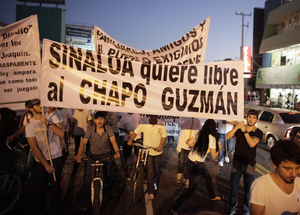 "Protesters carry a sign reading, ""Sinaloa wants Chapo Guzman free"" during a march in Culiacan February 26, 2014. More than a thousand people marched through the streets of the capital of captured drug lord Joaquin ""Shorty"" Guzman's home state in northwest Mexico on Wednesday, calling for his freedom. Guzman was captured on Saturday in a predawn raid in the beachside resort and fishing center of Mazatlan, around 125 miles (200 km) southeast of Culiacan. Picture taken February 26, 2014. REUTERS/Daniel Becerril (MEXICO - Tags: DRUGS SOCIETY CIVIL UNREST)"