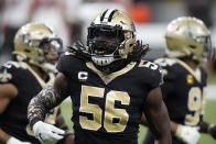 New Orleans Saints outside linebacker Demario Davis (56) reacts to a sack on Tampa Bay Buccaneers quarterback Tom Brady during the first half of an NFL divisional round playoff football game, Sunday, Jan. 17, 2021, in New Orleans. (AP Photo/Brynn Anderson)