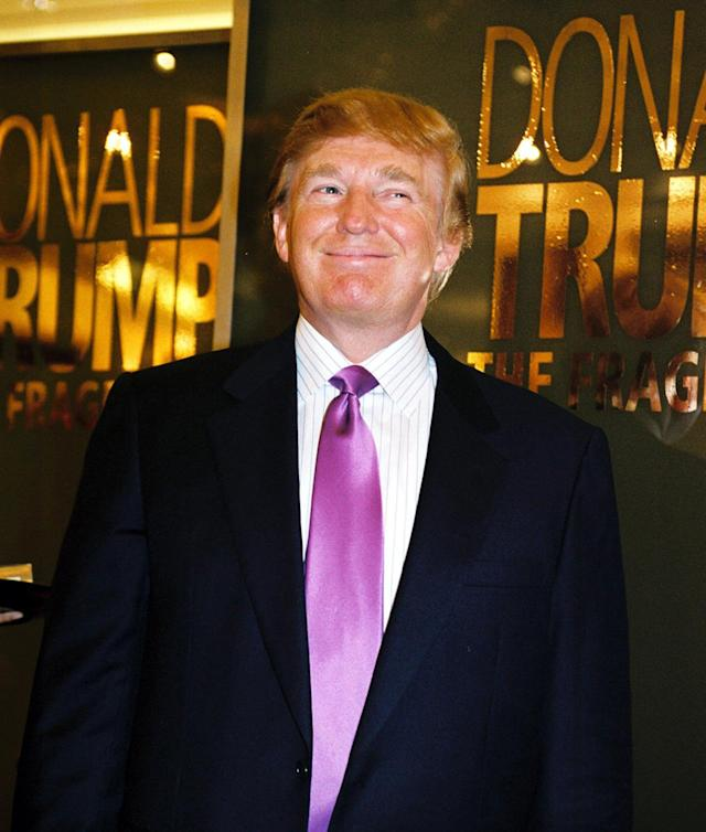 <p>Donald Trump makes a promotional appearance at Marshall Fields for his new cologne, the Fragrance, on Dec. 7, 2004, in Chicago. <i>(Photo: Scott Harrison/Getty Images)</i> </p>