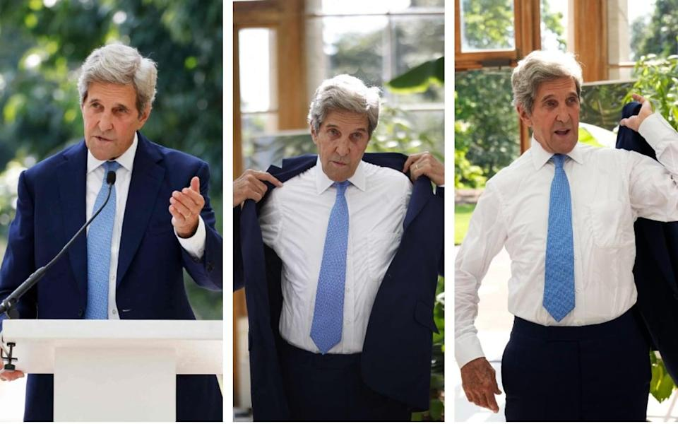 Too hot for a jacket: John Kerry addressed a sweltering Kew Gardens - GETTY IMAGES/AP